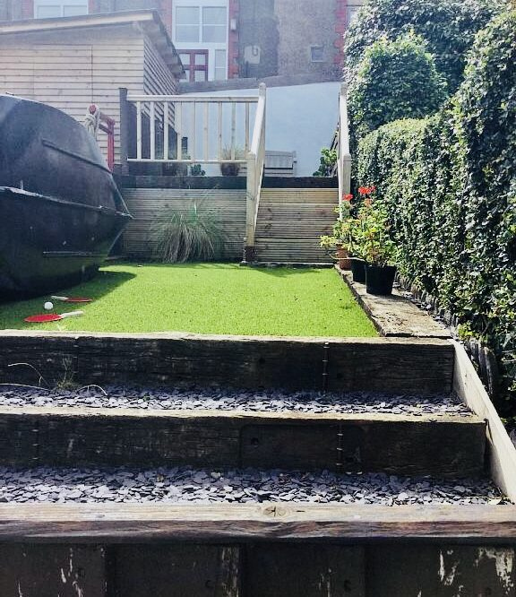 Enclosed separate rear garden with seating area